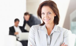 bigstockphoto_A_Happy_Business_Woman_With_Ot_5047791